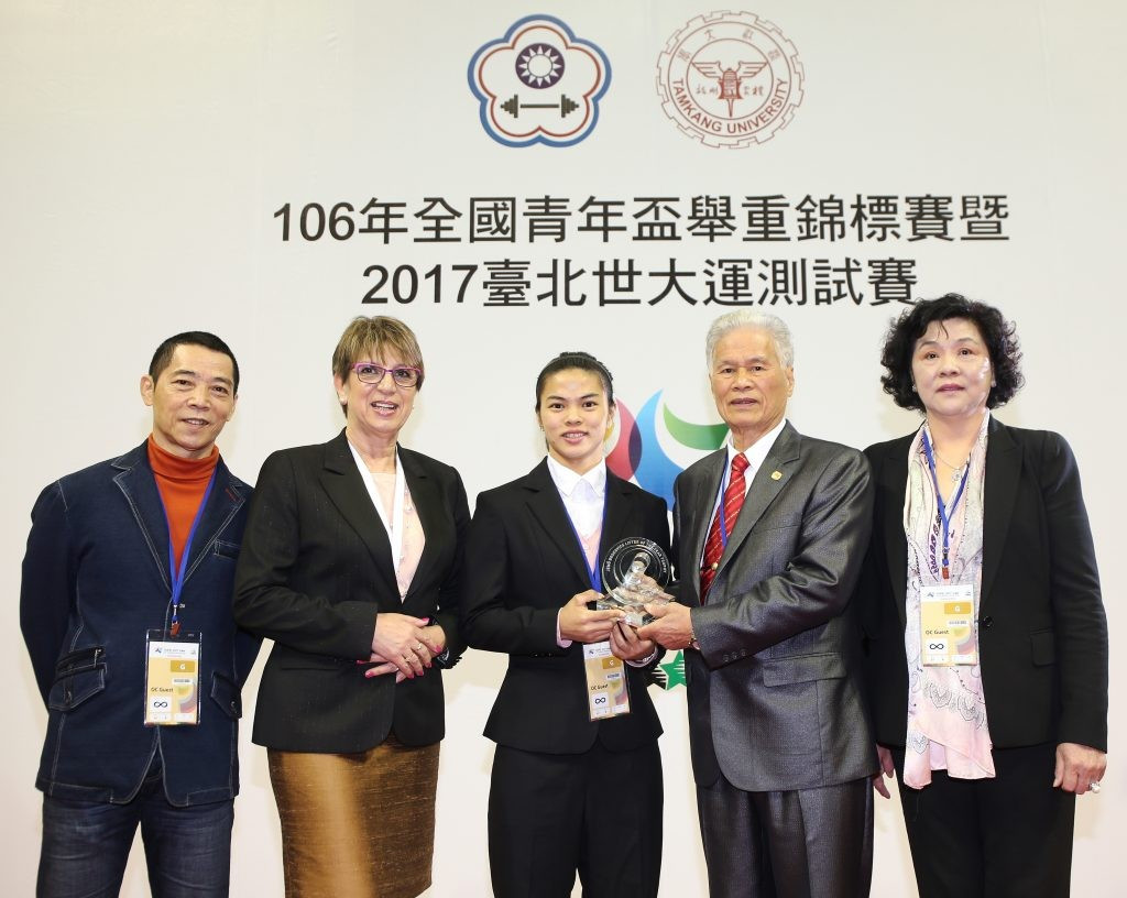 "During the test event's Opening Ceremony, Chinese Taipei's double Olympic champion Hsu Shu-Ching was presented with the ""Jenő Boskovics Lifter of the Year"" trophy ©IWF"