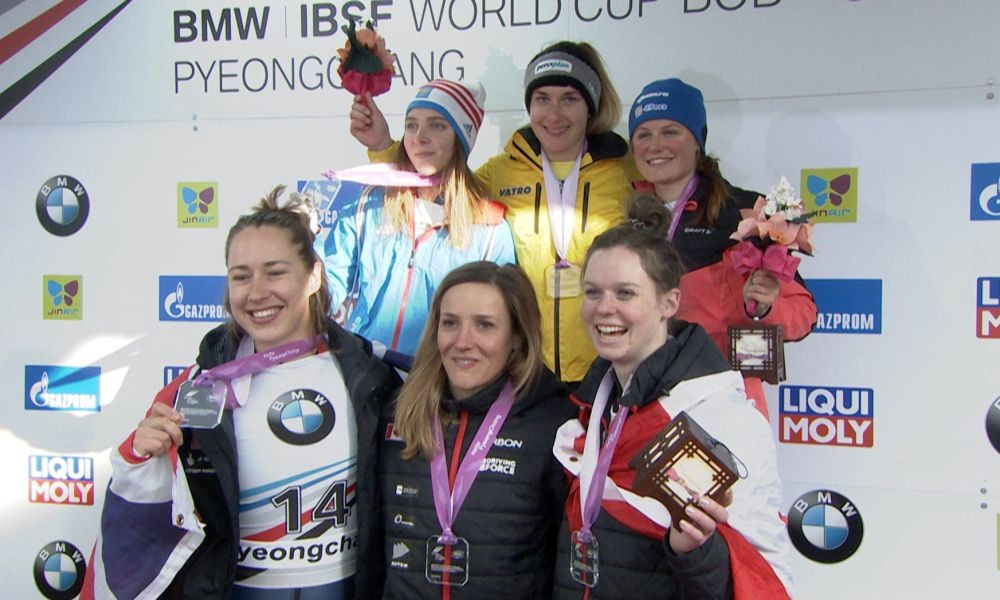 Germany's Jacqueline Lölling, centre of back row, claimed her third women's skeleton victory of the season to seal the overall World Cup ©IBSF