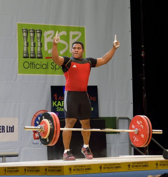 Home favourite Steven Kari produced one of the moments of the Games so far with a stunning victory in the men's 94kg weightlifting competition
