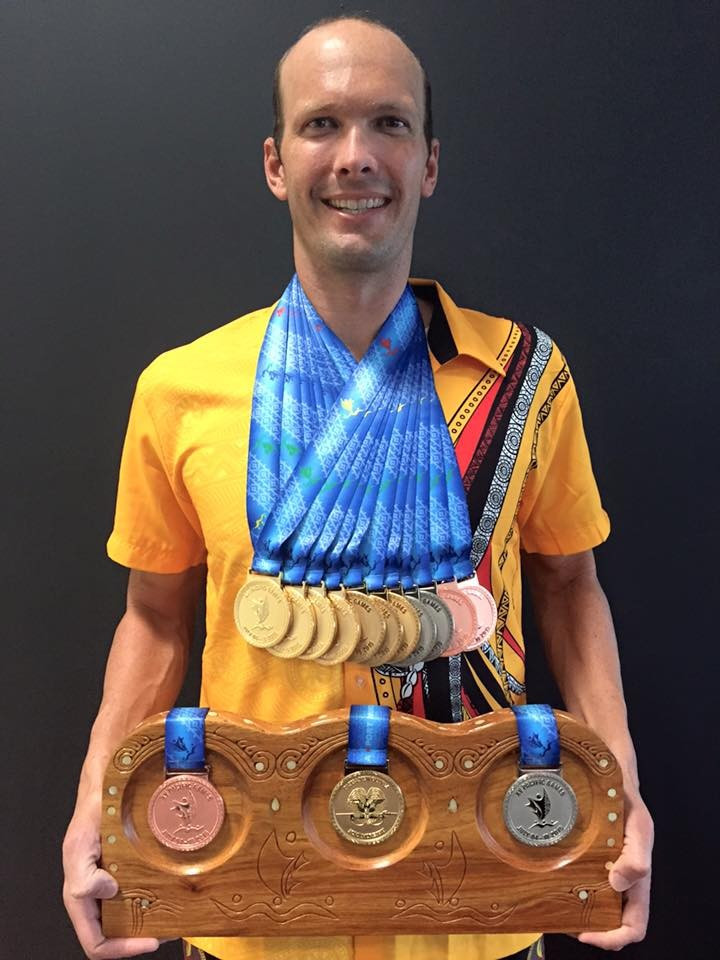 Ryan Pini poses with his haul of medals won during the swimming events at Port Moresby 2015 ©Ryan Pini/Facebook