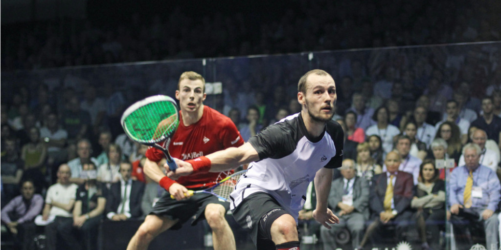Gregory Gaultier of France, left, returned to the top of the world rankings as he overcame England's Nick Matthew ©PSA