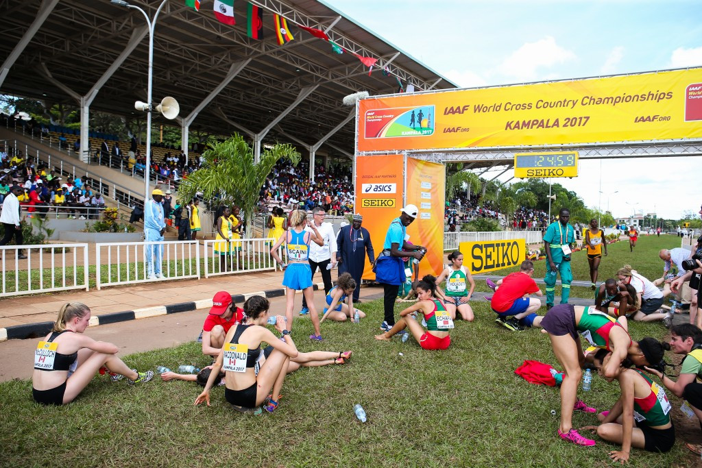 Exhausted athletes collapse after the finish line of the junior women's race at this year's World Cross Country Championships in Kamapla in Uganda ©Getty Images