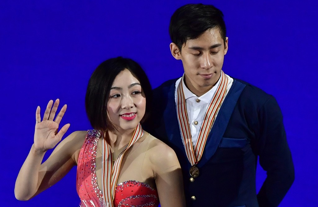 Sui and Han survive fall to win pairs skating world title