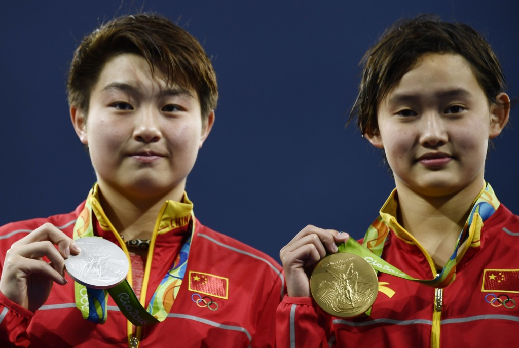 Ren Qian, right, and Si Yajie pictured celebrating with Olympic medals at Rio 2016 ©Getty Images