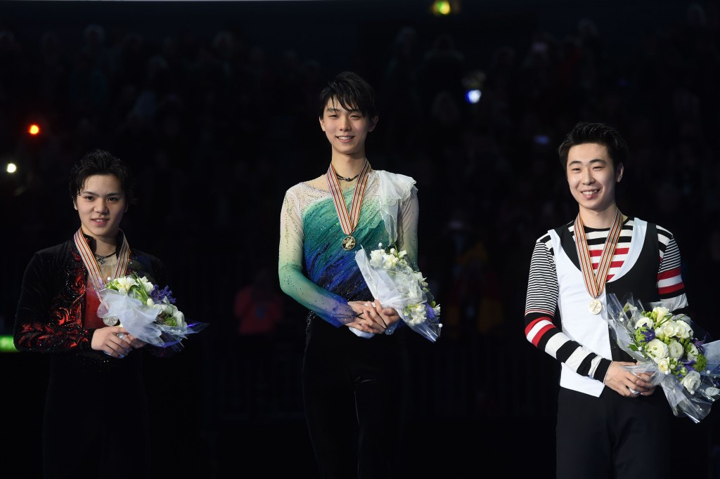 Yuzuru Hanyu, centre, led a Japanese one-two in the men's individual event ©Getty Images