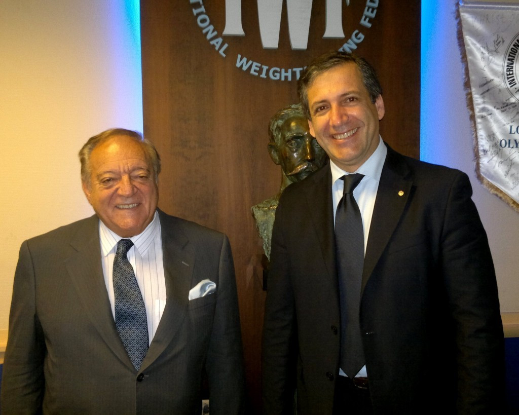 Antonio Urso, pictured right with Tamas Aján, has unveiled a new format for Olympic qualification as part of his IWF Presidency election campaign ©IWF