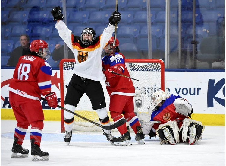 Germany's Yvonne Rothemund celebrates after her side scored an equaliser on their way to a 2-1 victory over Russia ©IIHF