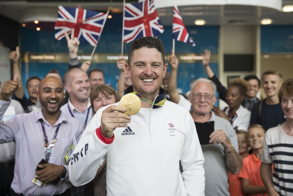 Justin Rose with his Olympic gold medal from Rio 2016. He will be in a group alongside Australia's Jason Day and Brandt Snedeker of the United States for the first two days ©Getty Images
