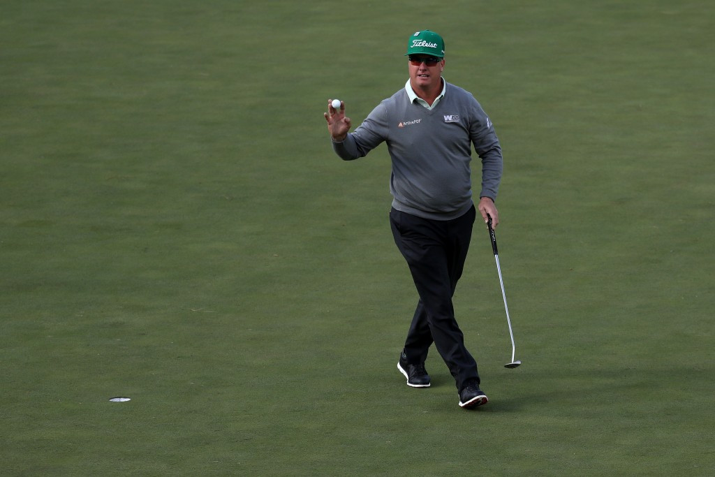 Hoffman leads Masters as injury forces Johnson's withdrawal