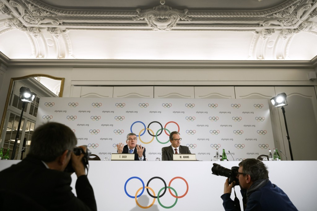 Rebecca Lowell Edwards will work with IOC Presidential spokesperson Mark Adams, right ®Getty Images