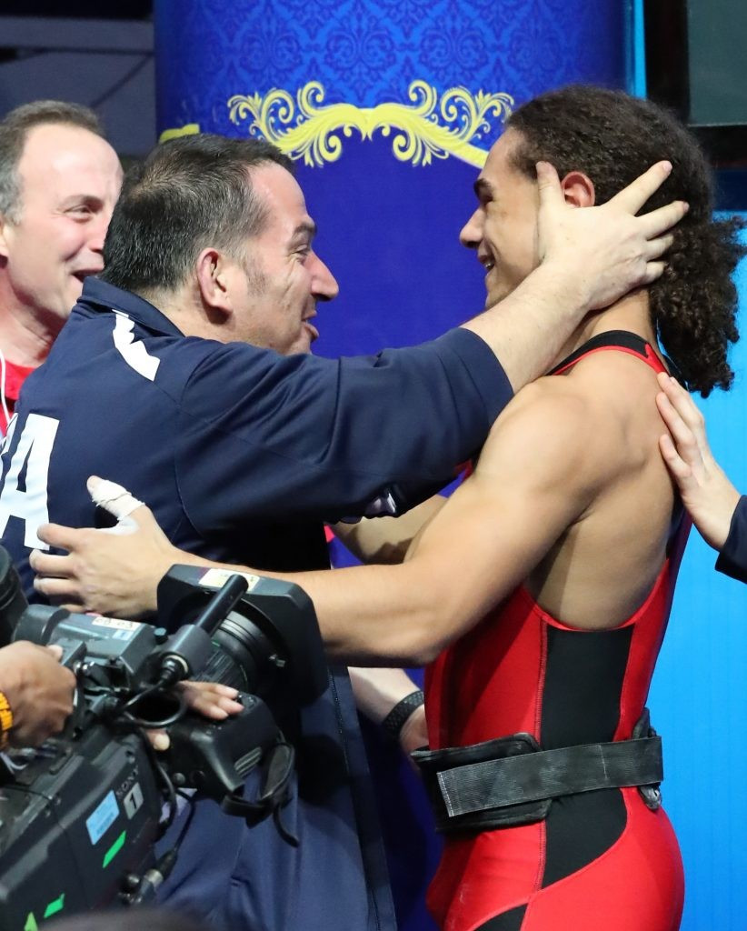 Harrison Maurus, right, is congratulated after his world record breaking effort ©IWF
