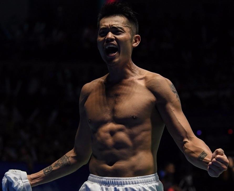 Lin wins battle of badminton heavyweights in Malaysia