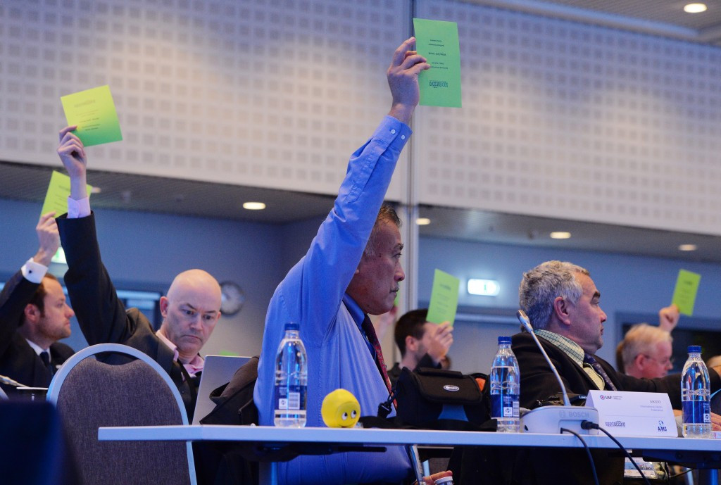 Delegates raise their cards to vote during the SportAccord General Assembly ©Getty Images