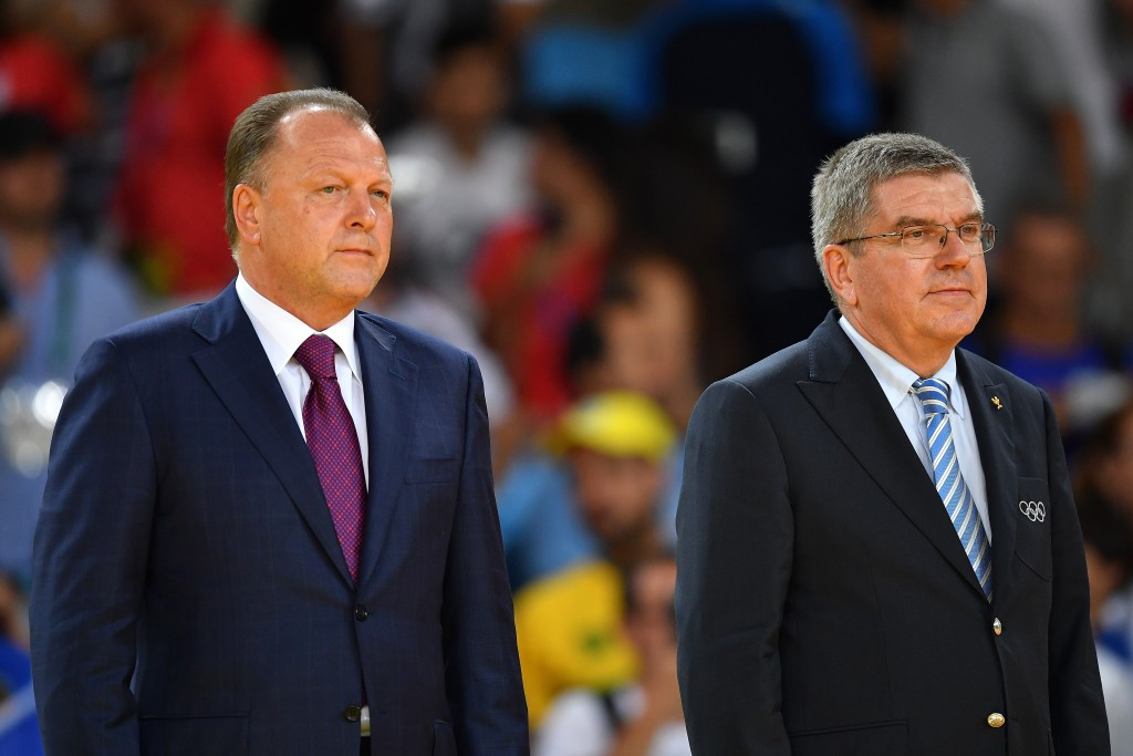 Former SportAccord President Marius Vizer, left, prepares for a Olympic medal ceremony at Rio 2016 alongside IOC President Thomas Bach, the man he had criticised so severely the previous year ©Getty Images