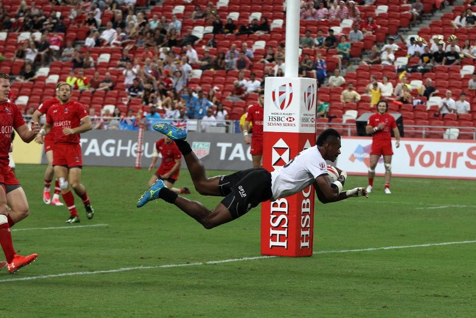 Three nations reach quarter-finals with 100 per cent record at Singapore Sevens