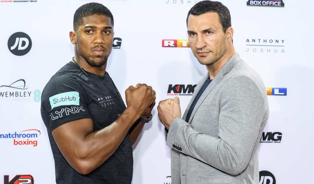 Anthony Joshua and Wladimir Klitschko pose at a pre-fight press conference ©Getty Images