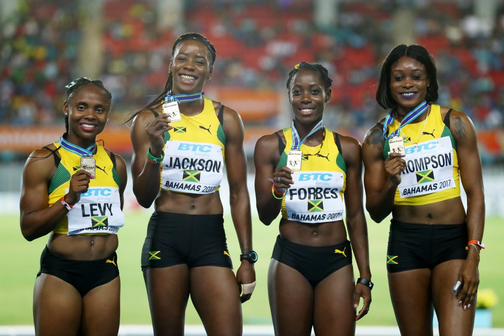 Double Olympic champion Elaine Thompson (right) anchored Jamaica to victory in the 4x200m at the IAAF World Relays in Nassau