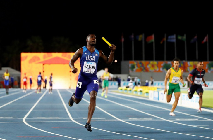 Justin Gatlin brings home the baton as the United States retain their 4x100m title at the IAAF/BTC World Relays in Nassau on a night when a faulty exchange put Jamaica out in the heats ©Getty Images for IAAF