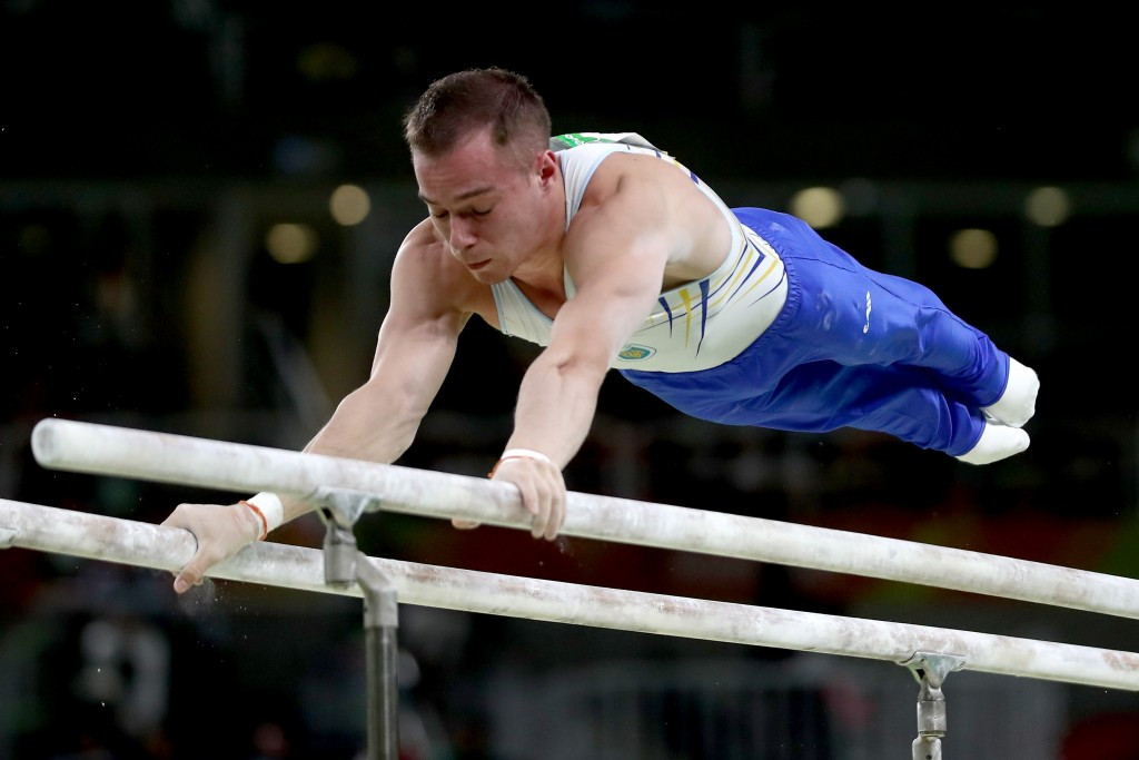 Olympic champion Oleg Verniaiev won the parallel bars gold medal ©Getty Images