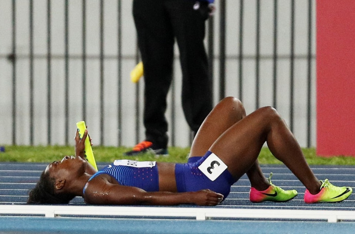 America's Olympic long jump champion Tianna Bartoletta fell on a track made slippery by earlier rain as she took the baton in the women's 4x100m in Nassau ©Getty Images for IAAF