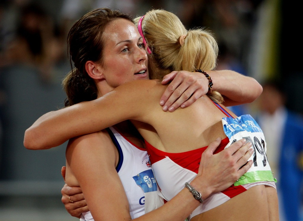 Kelly Sotherton, left, congratulates Tatyana Chernova after the final event of the Beijing Olympic heptathlon ©Getty Images