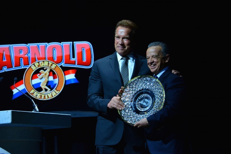 Rafael Santonja, right, pictured receiving a Lifetime Achievement award from Arnold Schwarzenegger during a bodybuilding show last year ©IFBB