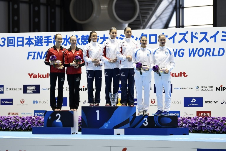 Japan, centre, also won the team event with a score of 184.7684 ©FINA