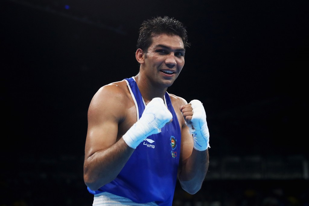 Commonwealth Games gold medallist Manoj Kumar secured his place in the quarter-finals of the welterweight division ©Getty Images