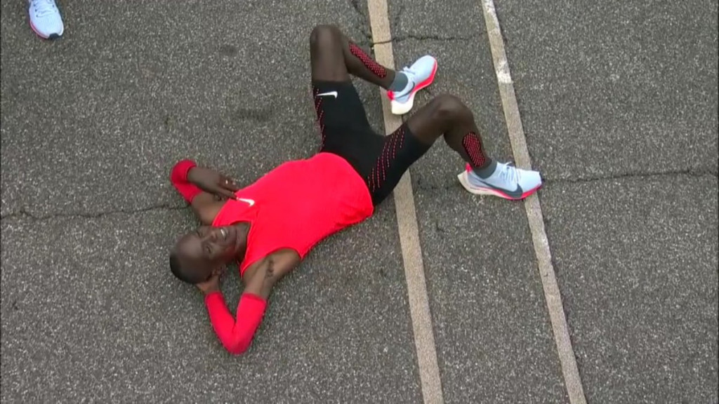 Eliud Kipchoge, Kenya's Olympic champion, briefly takes the weight off on the Monza track after running a 2:00:25 marathon as part of Nike's controversial Breaking2 project ©Twitter