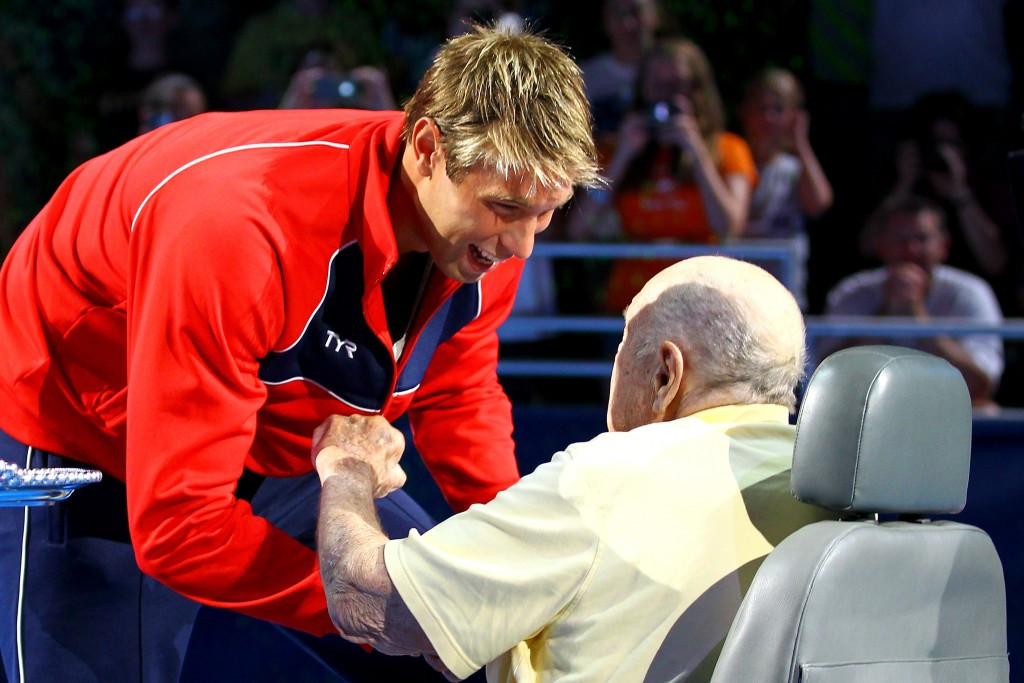 Quadruple Olympic champion Matt Grevers receives his gold medal from Adolph Kiefer at the 2012 US Olympic Swimming Team Trials ©Getty Images