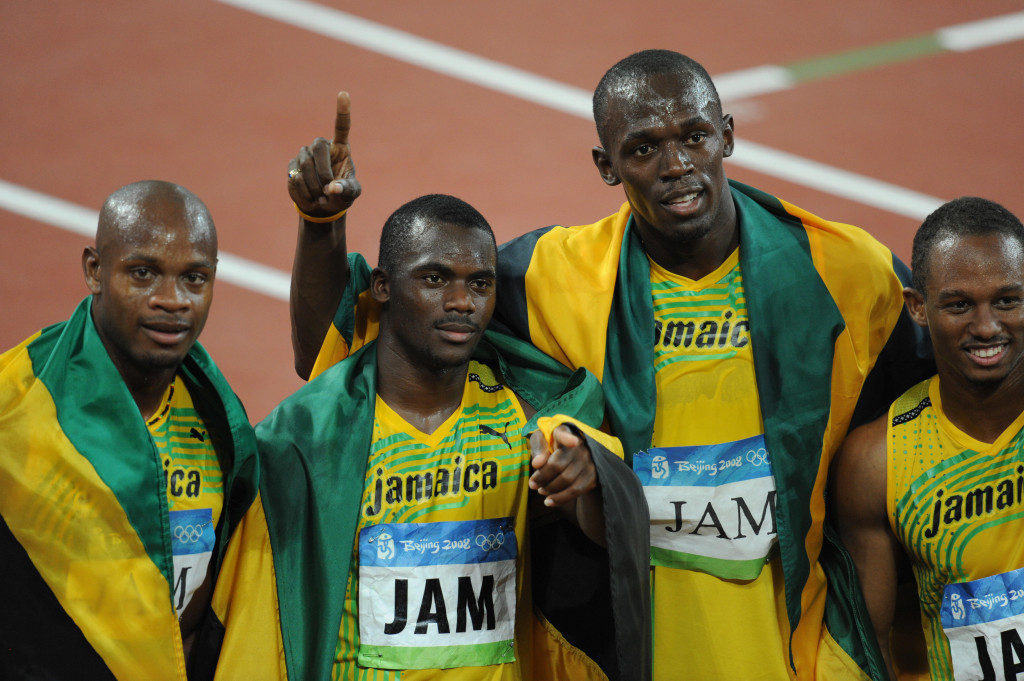 Jamaican sprinters Asafa Powell, left, and Nesta Carter, second left, each claim to have failed drugs tests due to taking supplements but were both still punished ©Getty Images