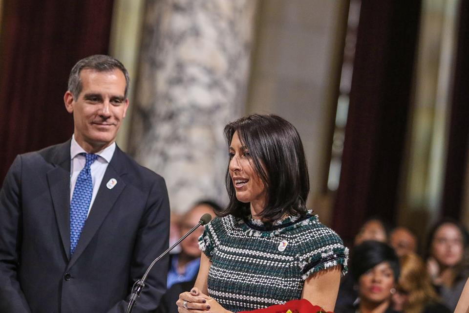 Janet Evans, four-times Olympic swimming gold  medallist, speaks at an LA Games event alongside the city's Mayor Eric Garcetti ©Getty Images