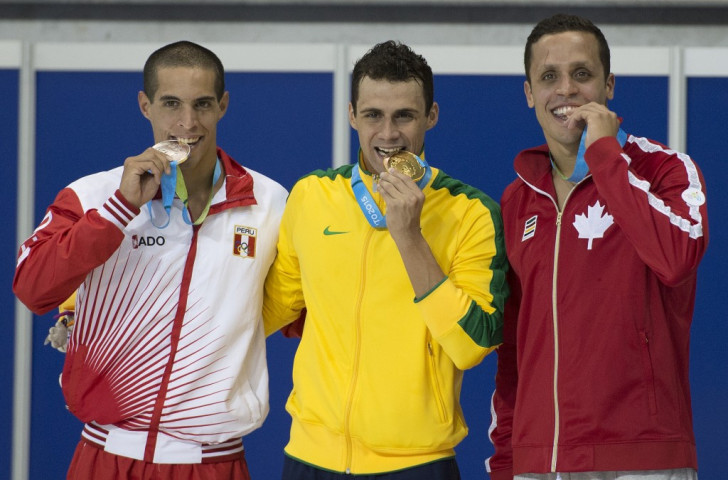 Mauricio Fiol (left) pictured celebrating his 200m butterfly silver medal which he is now set to be stripped of ©AFP/Getty Images