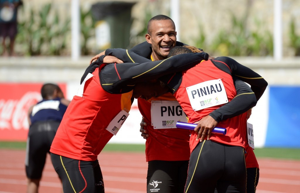 Papua New Guinea's men's 4x100m relay team celebrate their gold medal-winning performance at the Sir John Guise Stadium ©Port Moresby 2015