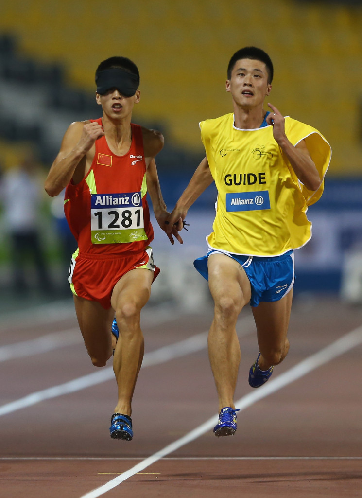 Dongdong Di clinched his third gold medal of the Grand Prix with victory in the men's 400m T11 ©Getty Images
