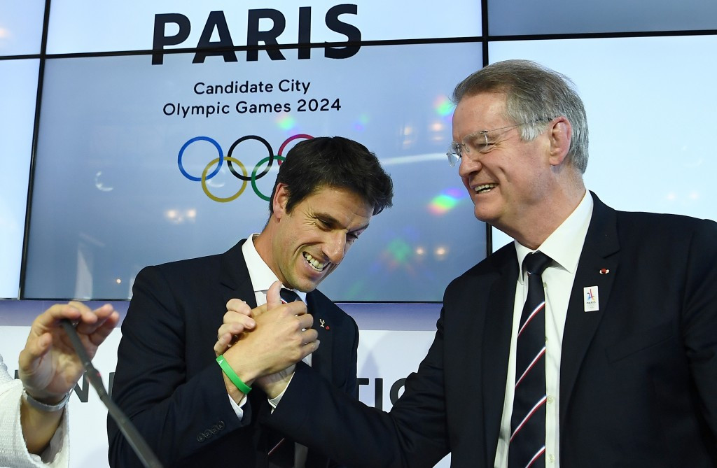 Paris 2024 co-bid leaders Tony Estanguet, left, and Bernard Lapasset celebrate at the end of the Evaluation Commission visit ©Getty Images