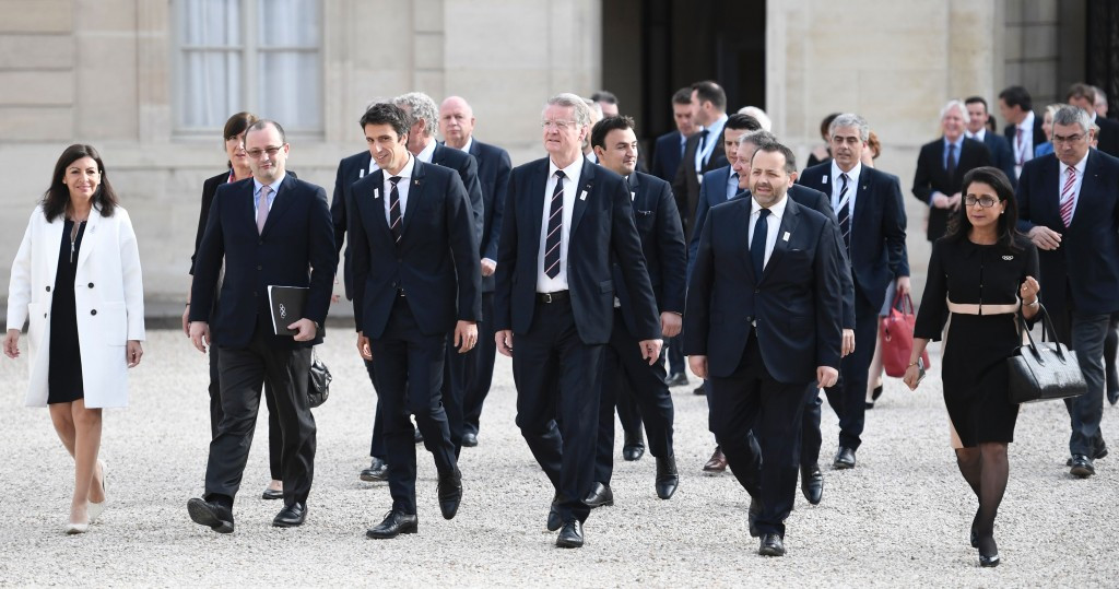 Paris 2024 and IOC officials walk to meet with Emmanuel Macron ©Getty Images