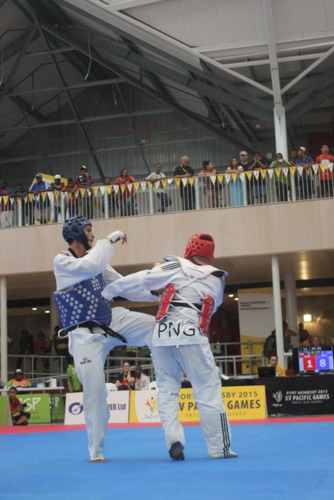 Tahiti's Lloyd Tuarai Hery (left) won gold in the men's over 87kg taekwondo category