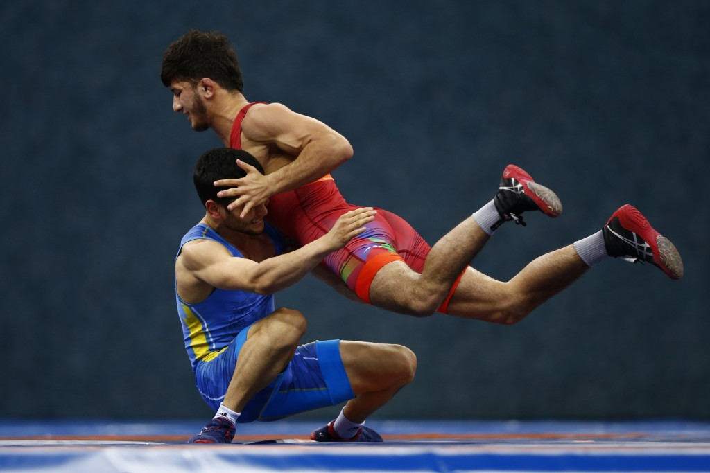 Mahir Amiraslanov, wearing red, won one of two wrestling golds for Azerbaijan today ©Getty Images