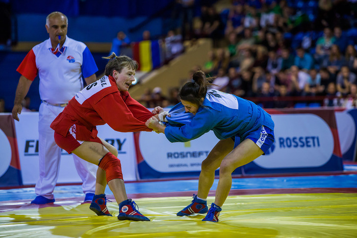 Russia were still the dominant force though with Elena Bondareva, left, winning the first of their five gold medals at the expense of Belarus' Leila Abbasava ©FIAS