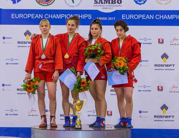 Ukraine's Anastasiya Shevchenko, second from left, topped the women's 60kg podium ahead of Russia's Arina Pchelintseva, left ©FIAS