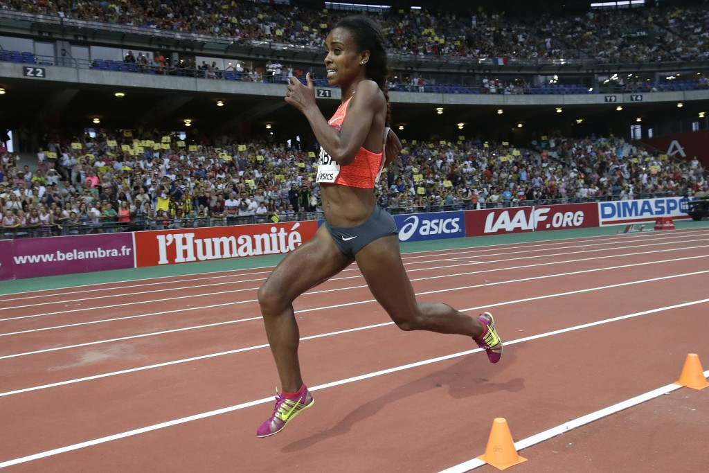 Genzebe Dibaba of Ethiopia kicks for home en route to setting a women's world 1500m record of 3:50.07 at tonight's IAAF Diamond League meeting in Monaco