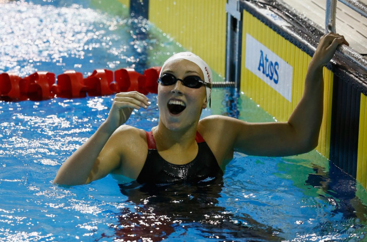 Redemption for Overholt as teenager secures stunning swimming gold at Toronto 2015