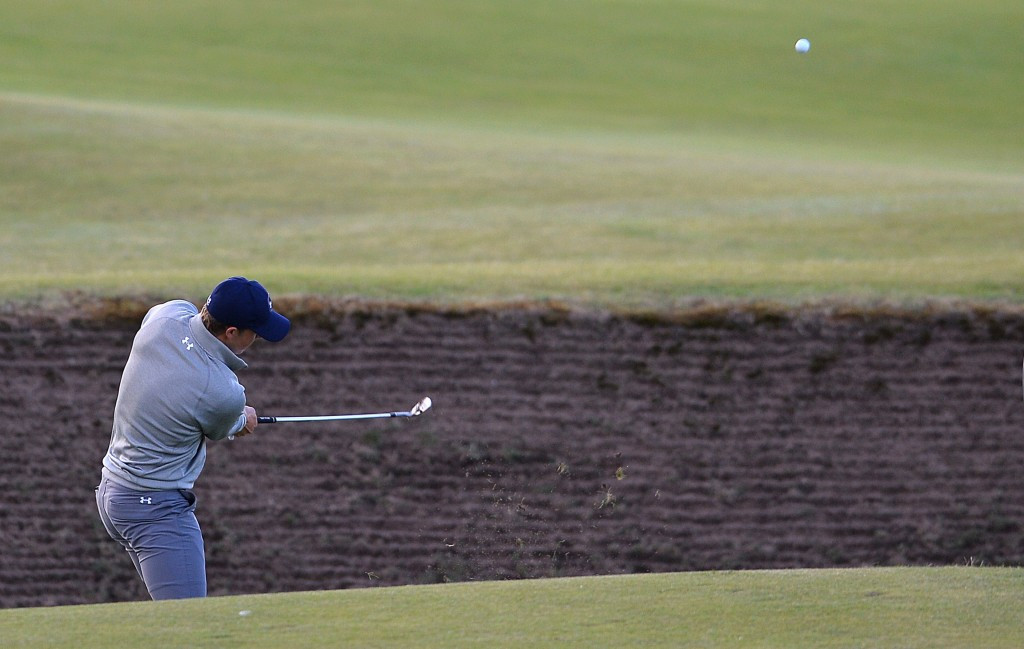 American Jordan Spieth is tied for 15th on five-under-par through 13 holes as his bid for a Grand Slam continues in the The Open at St Andrews