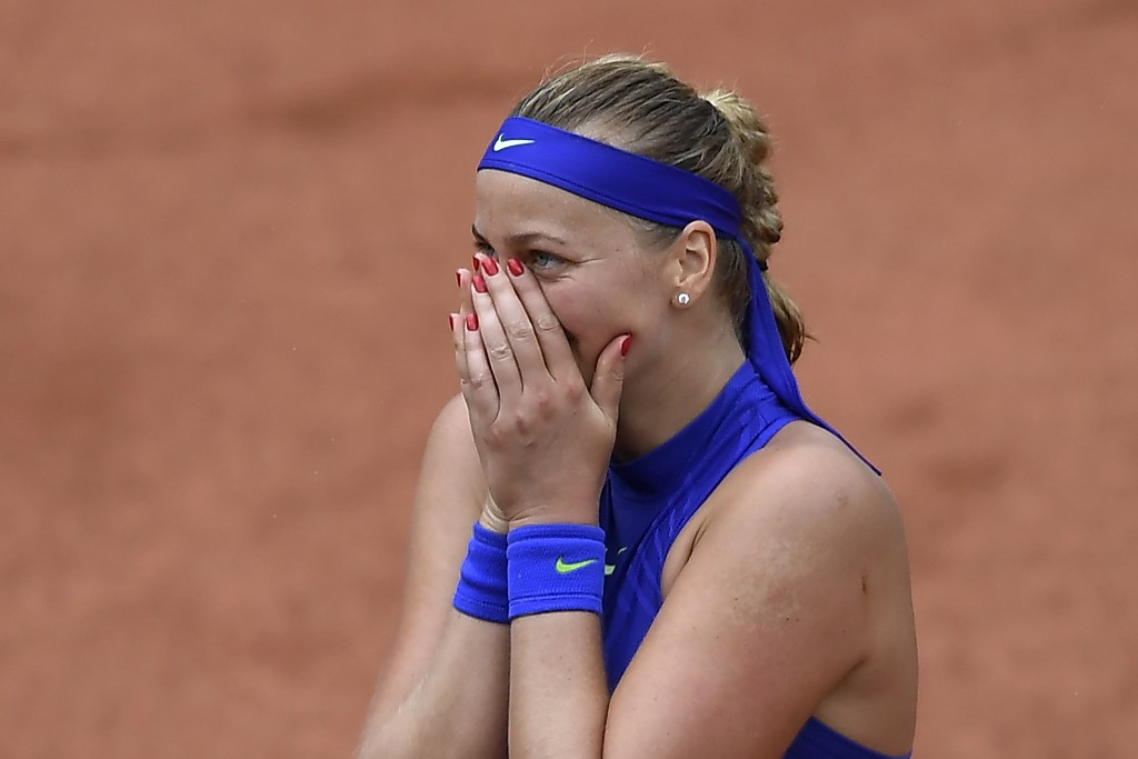 Kvitová marks competitive return with emotional win at French Open as top seed Kerber crashes out