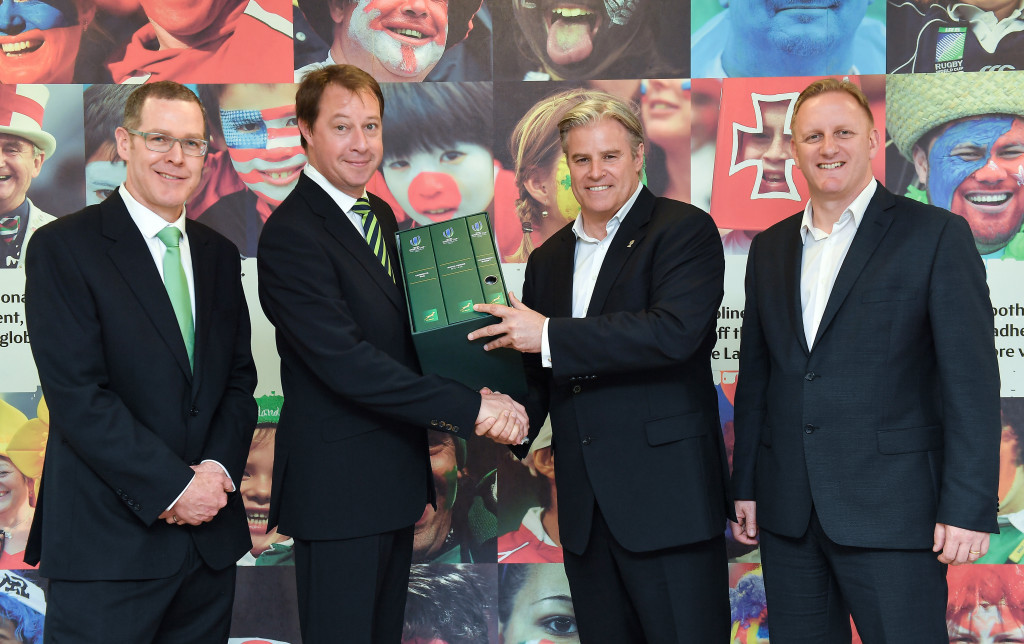 SA Rugby chief executive Jurie Roux, second from left, hands in the national governing body's bid submission for the 2023 Rugby World Cup to World Rugby counterpart Brett Gosper, second from right, with SA Rugby Bid Committee member Bruce Beckett, left, and Rugby World Cup head Alan Gilpin, right, also in attendance ©Getty Images