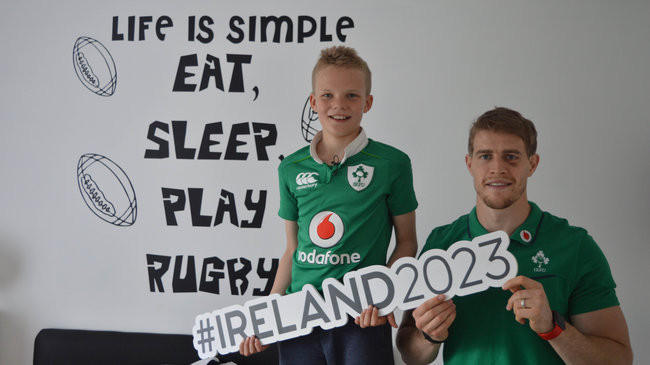 Ireland's submission for the 2023 Rugby World Cup is due to be handed in tomorrow by 11-year-old rugby player and fan Alex Place, who is pictured here with Ulster and Ireland winger Andrew Trimble ©IRFU