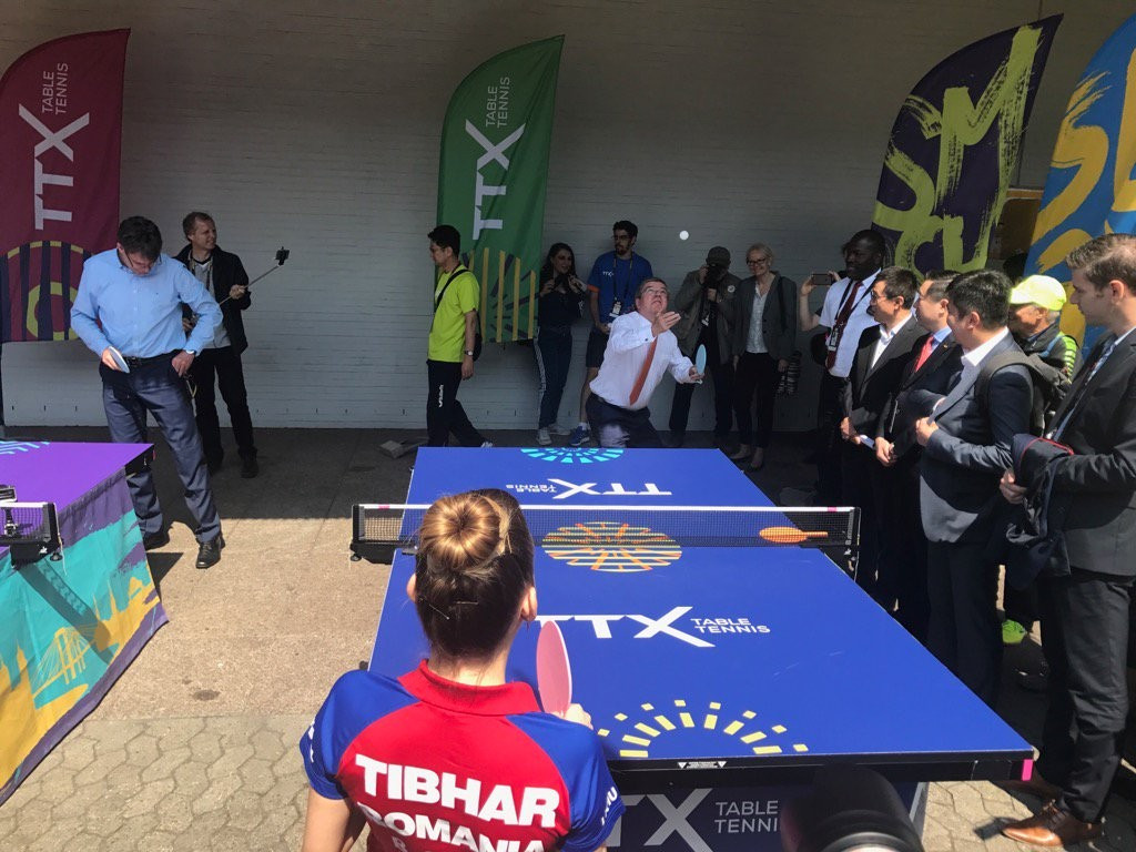 Thomas Bach playing table tennis during a visit to the ITTF World Championships today ©ITG