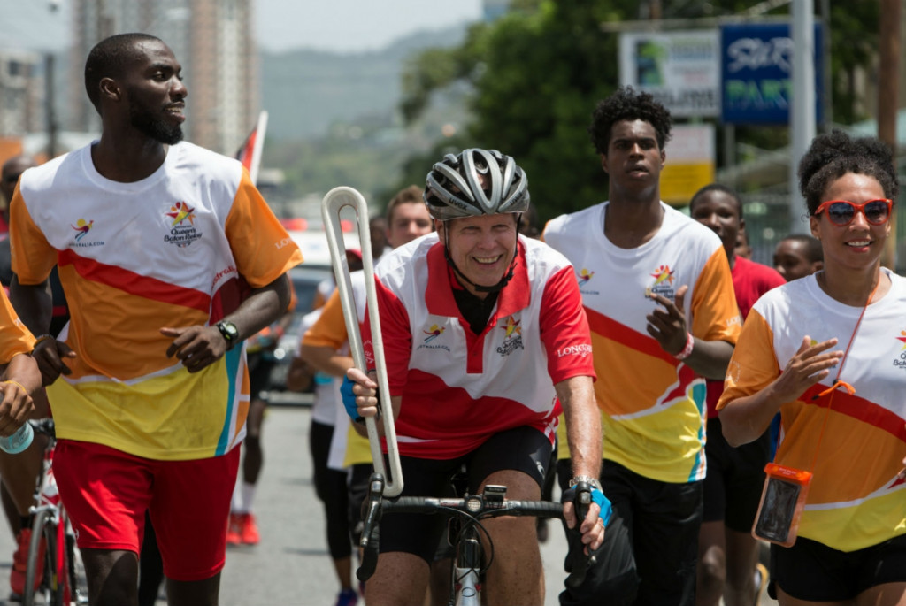 Roger Gibbon cycling with the Queen's Baton through Port of Spain ©Gold Coast 2018