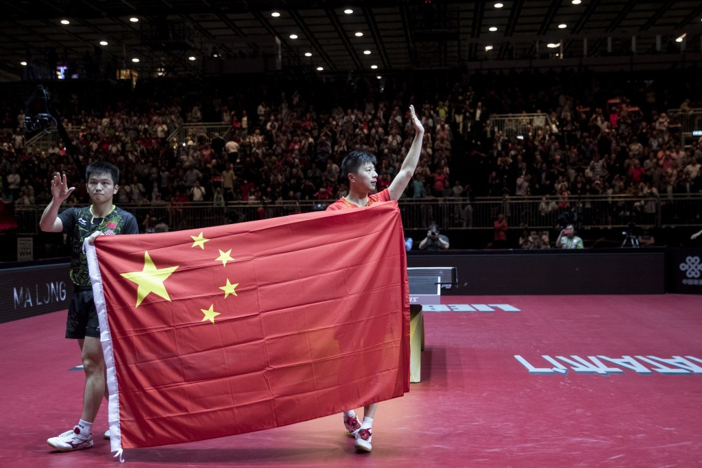 Fan Zhendong, left, and Ma Long pose after the men's singles final ©Getty Images